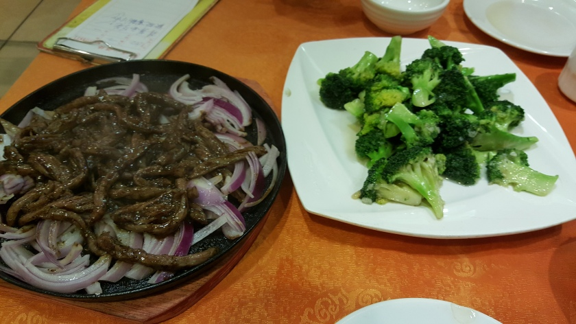 """If at first you don't succeed, eat some delicious food, take a nap, and try again tomorrow."" My day two travel routine strategy included this tasty meal of simmering beef and onions and stir-fry broccolli"