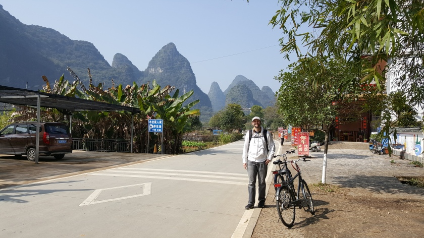Yangshuo, China karst mountains behind bike on road