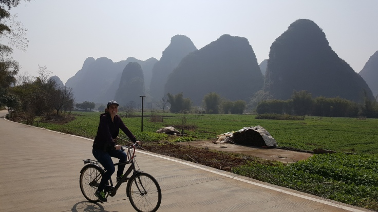 riding bicycle bike in Yangshu China at 10 Mile Gallery. Karst mountain and farm