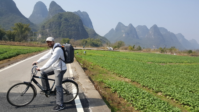 Farm and karst mountains with bike on road in Yangshuo China