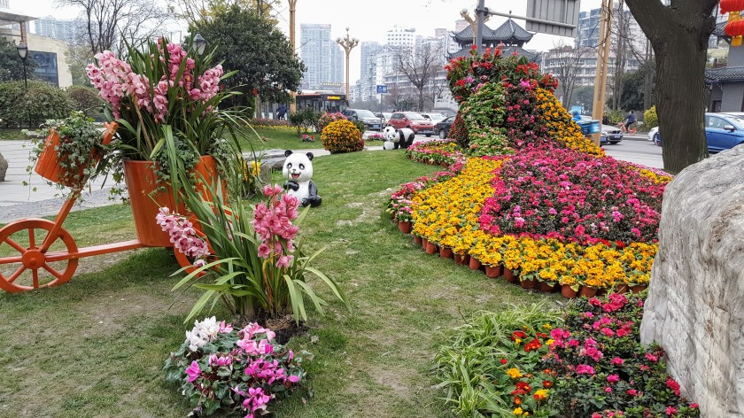 Grassy park with flower landscaping and panda statues in Chengdu, China