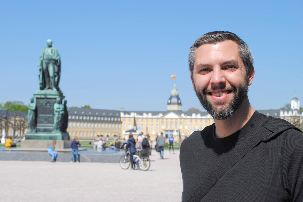 Josh standing in front of Karlsruhe Palace in Karlsruhe, Germany